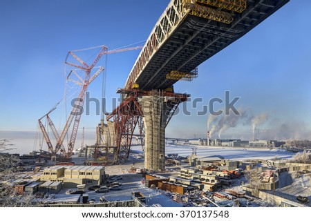 St.Petersburg, Russia - January 23, 2016: Road bridge, under construction, building of a double highway bridge, the Western High-Speed Diameter, through Sea Canal Saint Petersburg, sunny winter day.