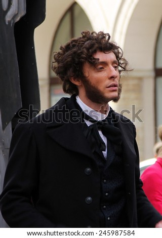 St. PETERSBURG, RUSSIA - JUL 5, 2014: Actor Iliya Del in image of the great Russian poet, Pushkin at the annual street celebration of birthday of another great writer, Feodor Dostoevsky - stock photo