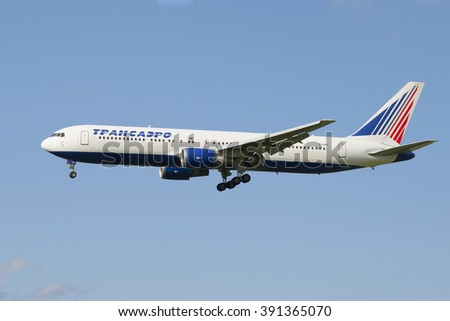 "ST. PETERSBURG, RUSSIA - JULY 24, 2015: Boeing 767-319 (EI-UNC) of the company ""Transaero"" before landing in Pulkovo airport"