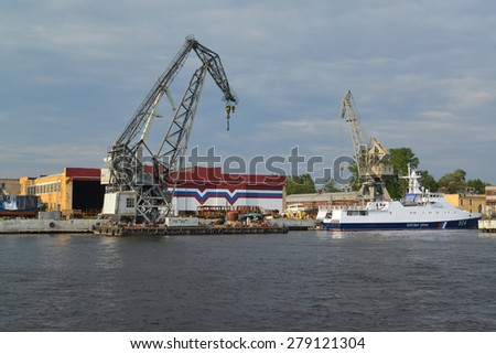 ST. PETERSBURG, RUSSIA - JULY 09, 2014:  Dry dock of shipbuilding plant