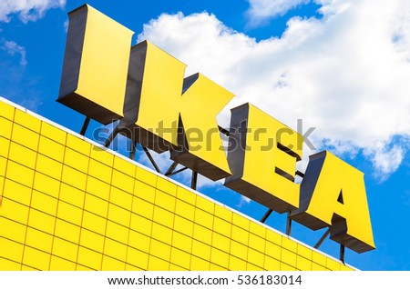 ST. PETERSBURG, RUSSIA - JULY 28, 2016: IKEA logo against blue sky. IKEA is the world's largest furniture retailer and sells ready to assemble furniture
