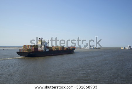 ST. PETERSBURG, RUSSIA - JULY 25, 2014: Ocean container ship leaves the Kronstadt raid in the Gulf of Finland