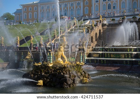 ST. PETERSBURG, RUSSIA - JULY 03, 2015: Statue of Samson in the bowl of a Large cascade on a Sunny summer day. Peterhof