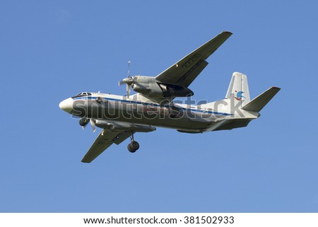 "ST. PETERSBURG, RUSSIA - JULY 24, 2015: The plane AN-26-100 ""Marshal Novikov"" (RA-27210) landing in Pulkovo airport"