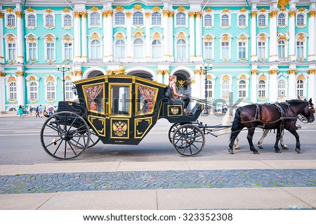 ST. PETERSBURG, RUSSIA - JULY 26, 2015:  Tourists in carriage at Palace Square near Winter Palace in St. Petersburg, Russia