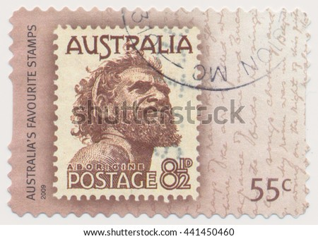 ST. PETERSBURG, RUSSIA - JUNE 22, 2016: A postmark printed in Australia, shows Aborigine (1950) series old postage stamp on a new, circa 2009 - stock photo