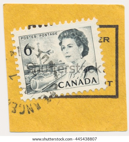 ST. PETERSBURG, RUSSIA - JUNE 29, 2016: A postmark printed in CANADA, shows envelope cutting and portrait of Queen Elizabeth II and transport, circa 1968