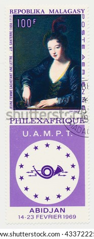 ST. PETERSBURG, RUSSIA - JUNE 8, 2016: A postmark printed MALAGASY, shows Lady Sealing Letter by Jean Baptiste Santerre. Issued to publicize PHILEXAFRIQUE Philatelic Exhibition in Abidjan, circa 1969 - stock photo