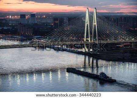 St. Petersburg, Russia - June 1, 2015: Cable-stayed bridge across the river Neva river at night during the navigation.