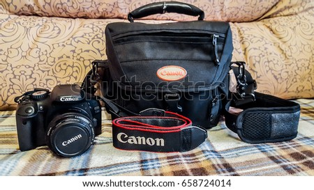 St.Petersburg, Russia, June 2017: Canon camera EOS 550D with bag.