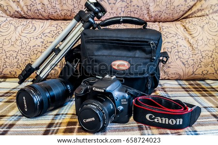 St.Petersburg, Russia, June 2017: Canon camera EOS 550D with bag and tripod and additional lens.