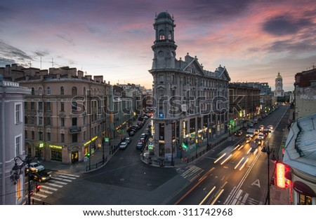 ST. PETERSBURG, RUSSIA - JUNE  21, 2015: Famous road crossing called Five Corners. One of symbols of city is Apartment house with turret - stock photo