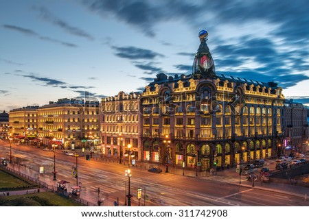 ST. PETERSBURG, RUSSIA - JUNE 17, 2015: Singer building and evening Nevsky avenue. Singer building was built in 1902-1904 - stock photo