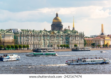 ST PETERSBURG, RUSSIA - JUNE 13, 2014: Tourist boats floating on the Neva River. St. Petersburg was the capital of Russia and attracts many tourists. - stock photo