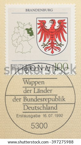 ST. PETERSBURG, RUSSIA - MAR 28, 2016: A first day of issue postmark printed in Bonn, Germany, shows Coats of Arms Brandenburg and map of States of the Federal Republic of Germany, circa 1992 - stock photo