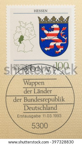 ST. PETERSBURG, RUSSIA - MAR 28, 2016: A first day of issue postmark printed in Bonn, Germany, shows Coats of Arms Hesse, and map of States of the Federal Republic of Germany, circa 1993 - stock photo