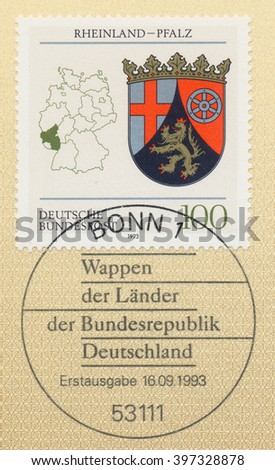 ST. PETERSBURG, RUSSIA - MAR 28, 2016: A first day of issue postmark printed in Bonn, Germany, shows Coats of Arms Rhineland-Palatinate and map of States of the Federal Republic of Germany, circa 1993 - stock photo