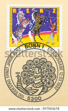 ST. PETERSBURG, RUSSIA - MAR 28, 2016: A first day of issue postmark printed in Bonn, Germany, shows Two horses in the circus arena devoted Ernst Jakob Renz (1815-1892), Circus Director, circa 1992 - stock photo