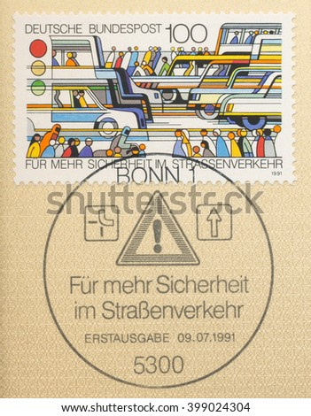 ST. PETERSBURG, RUSSIA - MAR 30, 2016: A first day of issue postmark printed in Bonn, Germany, shows street, transportation, pedestrians, road sign, Traffic Safety, circa 1991 - stock photo