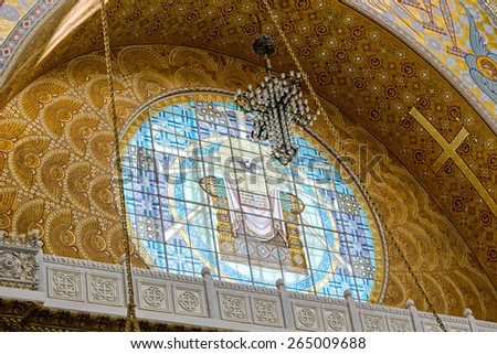 St Petersburg, Russia - March 19, 2015: Ornate interior of the Naval Cathedral of Saint Nicholas in Kronstadt, near Saint-Petersburg, Russia. Stained-glass window. Religious paintings and icons