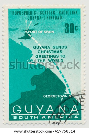 ST. PETERSBURG, RUSSIA - MAY 13, 2016: A postmark GUYANA, shows Map showing connection between Guyana and Trinidad. All stamps are inscribed: Guyana Sends Christmas Greetings to the World, circa 1968 - stock photo