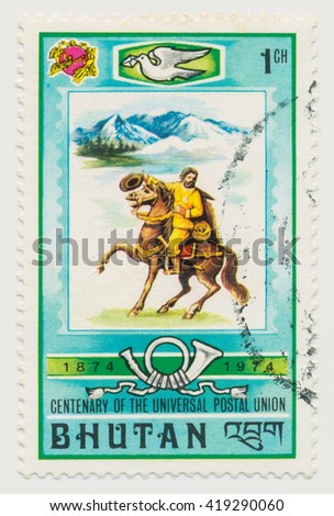 ST. PETERSBURG, RUSSIA - MAY 11, 2016: A postmark printed in BHUTAN, shows Mailman on Horseback, circa 1974 - stock photo