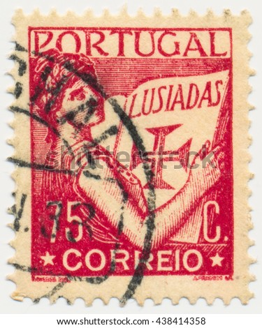 ST. PETERSBURG, RUSSIA - MAY 17, 2016: A postmark printed in PORTUGAL, shows Portugal Holding Volume of  Lusiads, circa 1931 - stock photo