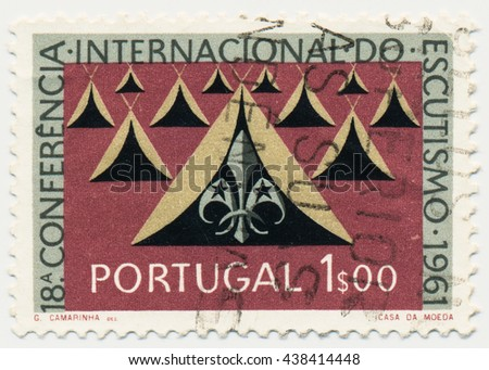 ST. PETERSBURG, RUSSIA - MAY 17, 2016: A postmark printed in PORTUGAL, shows Tents and Scout Emblem, series 50th anniv. of the Portuguese Boy Scouts and the 18th Conf., Sept. 19-24, 1961, circa 1961 - stock photo