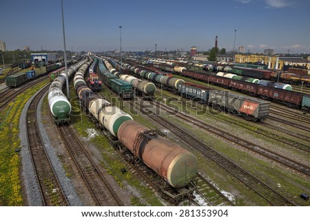 St. Petersburg, Russia - May 22, 2015: big railway cargo station junction with lot of trains and track lines, Freight Station with trains, Freight train pulling several box and tank cars on summer day