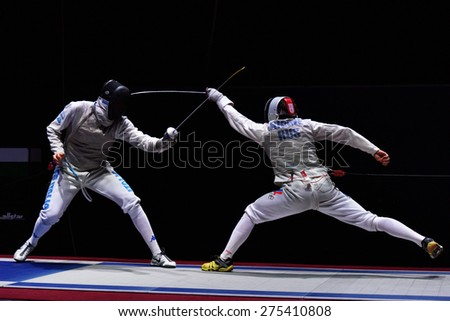 ST. PETERSBURG, RUSSIA - MAY 2, 2015: Dmitry Rigin of Russia vs Andrea Cassara of Italy in the final of International fencing tournament St. Petersburg Foil. The tournament is the stage of World Cup - stock photo