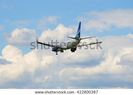 "ST. PETERSBURG, RUSSIA - MAY 17, 2016: Flying away in a cloudy sky airplane Boeing 737-800NG (VP-BEP) airline ""Yakutia"""
