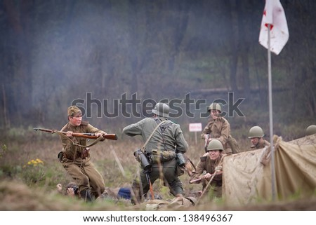 ST. PETERSBURG, RUSSIA - MAY 12: Historical reenactment of the combats in may 1945 in Czechoslovakia on May 12, 2013 in St. Petersburg, Russia.