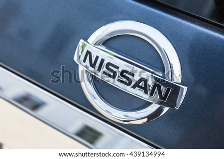 St-Petersburg, Russia - May 15, 2016: Nissan car logo mounted on rear door of Nissan X-Trail SUV, closeup photo with selective focus - stock photo