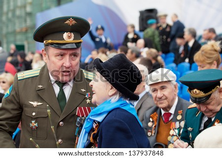 ST. PETERSBURG, RUSSIA - MAY 9: Old veterans of  WWII  decorated with orders and medals during festivities devoted to anniversary of Victory Day on May 9, 2013 in Saint- Petersburg