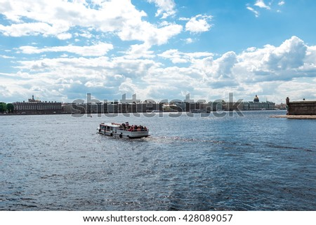 St.Petersburg, Russia - May 17, 2016: passenger boat floating by Neva river. View from Peter and Paul fortress.