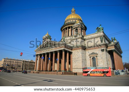 ST. PETERSBURG, RUSSIA MAY 08: People walking near Saint Isaac Cathedral's main entrance in sunny day on May 08, 2015 in St. Petersburg, Russia. The Cathedral has the collection of monumental art