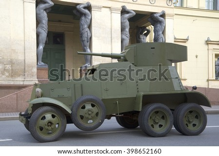 ST. PETERSBURG, RUSSIA - MAY 05, 2015: Soviet cannon armored car 30-ies BA-3 on the background of the portico of the New Hermitage