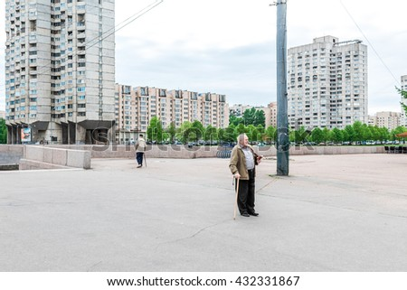 St. Petersburg, Russia - May 19, 2016: Two elder men with walking-sticks on Novo Smolenskaya embankment on Vasilevsky Island.