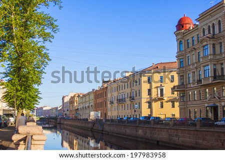 St. Petersburg, Russia, May 31, 2011. View on embankment of Griboyedov Canal and its reflection in the water early in the morning