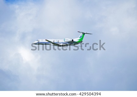 ST PETERSBURG, RUSSIA - MAY 11, 2016. VQ-BWO Komiaviatrans State Air Enterprise Embraer 145 airplane is flying in the sky after departure from Pulkovo International airport