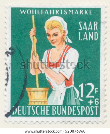 ST. PETERSBURG, RUSSIA - NOV 8, 2016: A postmark printed in SAAR, shows Dairy Maid, circa 1958