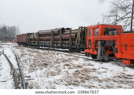 St. Petersburg, Russia November 13, 2015:  Warehouse large diameter steel pipes outdoors, handling operations and accounting products