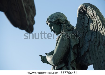 St.Petersburg, Russia - October 21: Arkhangelsk balustrade on the roof of St. Isaac's Cathedral. Sculpture of the Archangel. - stock photo
