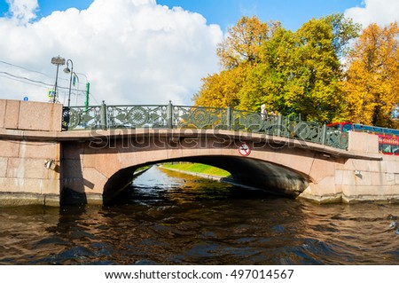 ST PETERSBURG, RUSSIA-OCTOBER 3, 2016. Autumn landscape of St Petersburg - Lower Swan bridge over the Swan Canal located on the Moika river embankment in St Petersburg, Russia