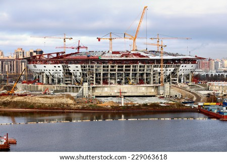 St. Petersburg, Russia - October 30, 2014: Construction of soccer sports stadium for the local football team called the Zenith. Building under construction multipurpose sports arena. - stock photo