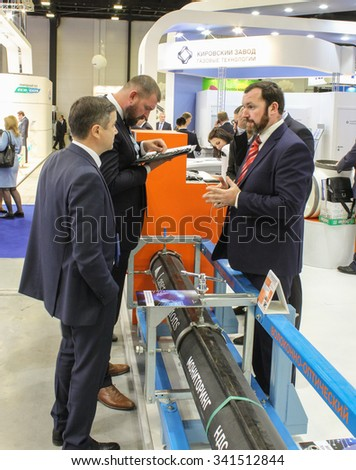 St. Petersburg, Russia - 7 October, 2015. Expo forum. International Gas Forum. Business people talk at the stand of the company.