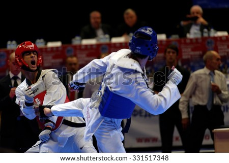 ST. PETERSBURG, RUSSIA - OCTOBER 17, 2015: Taekwondo WTF junior teams match Russia vs Iran during the martial arts festival Baltic Sea Cup in Sibur Arena. Iran won the match - stock photo