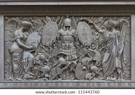 ST.PETERSBURG, RUSSIA - SEP 11:The pedestal of the Alexander Column is decorated with symbols of military glory, sculpted by Giovanni Battista Scotti, in St.Petersburg, Russia on Sep 11, 2012 - stock photo