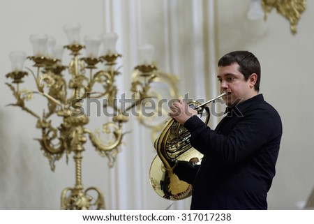 """ST. PETERSBURG, RUSSIA - SEPTEMBER 7, 2015: Musician of """"Choir of French horns"""" on the rehearsal during the International festival of French horn. The hornfest is held 3rd time - stock photo"""