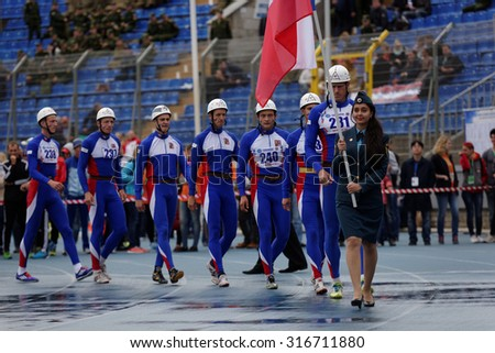 ST. PETERSBURG, RUSSIA - SEPTEMBER 9, 2015: Team Czech Republic before competitions in combat deployment during XI World Championship in Fire and Rescue Sport. 1st World Championship was held in 2002 - stock photo